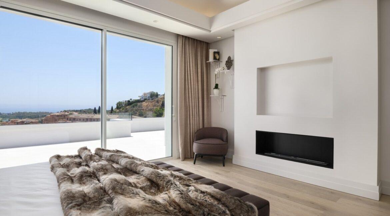 5 bedroom golf and sea view villa in El Paraiso Estepona bedroom fire place